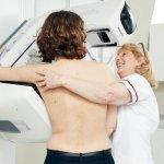 Breast screening machine nurse with patient