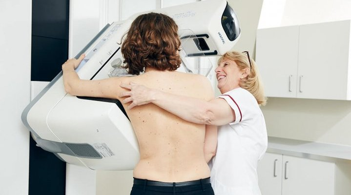 Breast screening machine nurse with patient