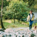 Couple with dog hiking in forest