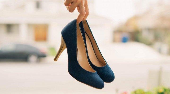 Hand close up holding stilettos